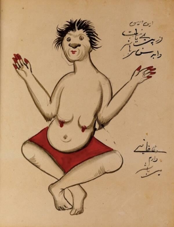 Демон с котешко лице сред страниците на ръкописа от началото на 20 век. Текстът е открит в Исфахан, град в Иран.